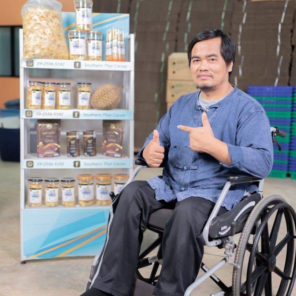 Thawat Khoniak (Hneng, fine robusta producer from Thailand in a wheelchair)
